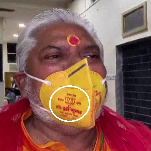 Bihar Minister Prem Kumar in trouble for wearing lotus mask