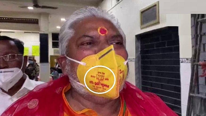Bihar Minister Prem Kumar in trouble for wearing lotus mask