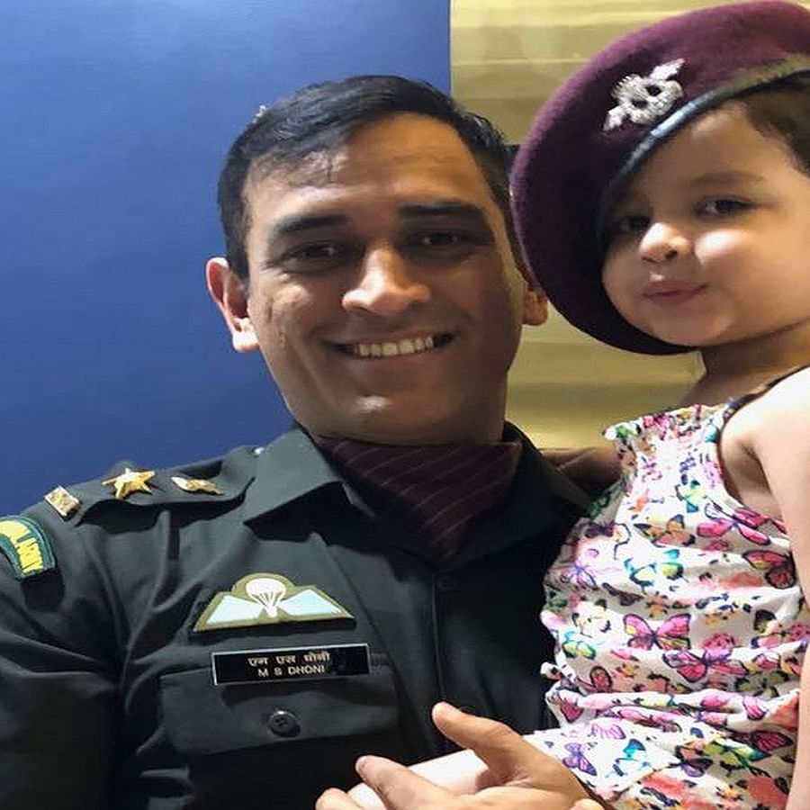 Mahendra Singh Dhoni and her daughter