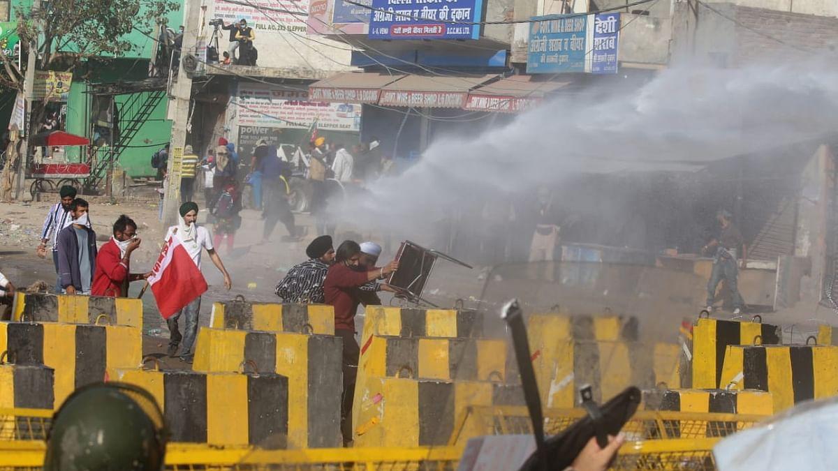 Rajasthan-Haryana border: Cops use water cannon, tear gas as farmers break through barricades