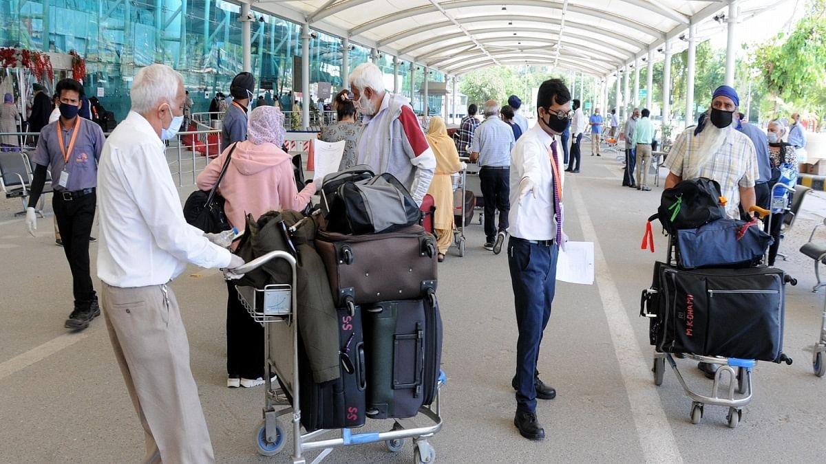 Fresh COVID-19 strain in UK: 262 passengers, 10 crew members stuck at Amritsar airport, relatives protest