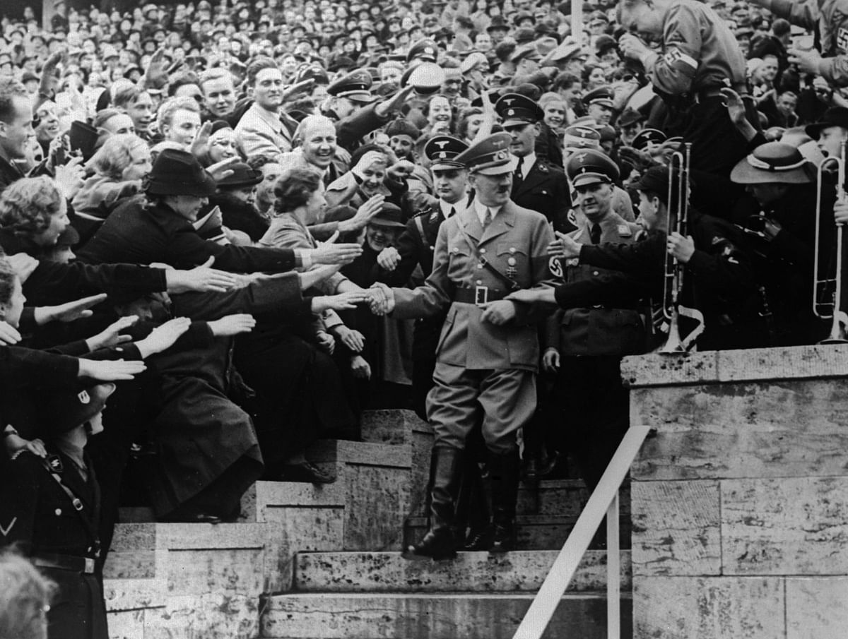 Adolf Hitler surrounded by an adoring crowd (Photo by Keystone/Getty Images)