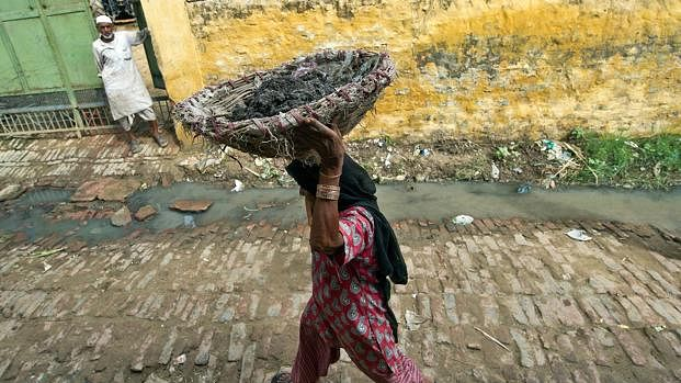 A Dalit woman carrying human waste on her head. (Representative image)