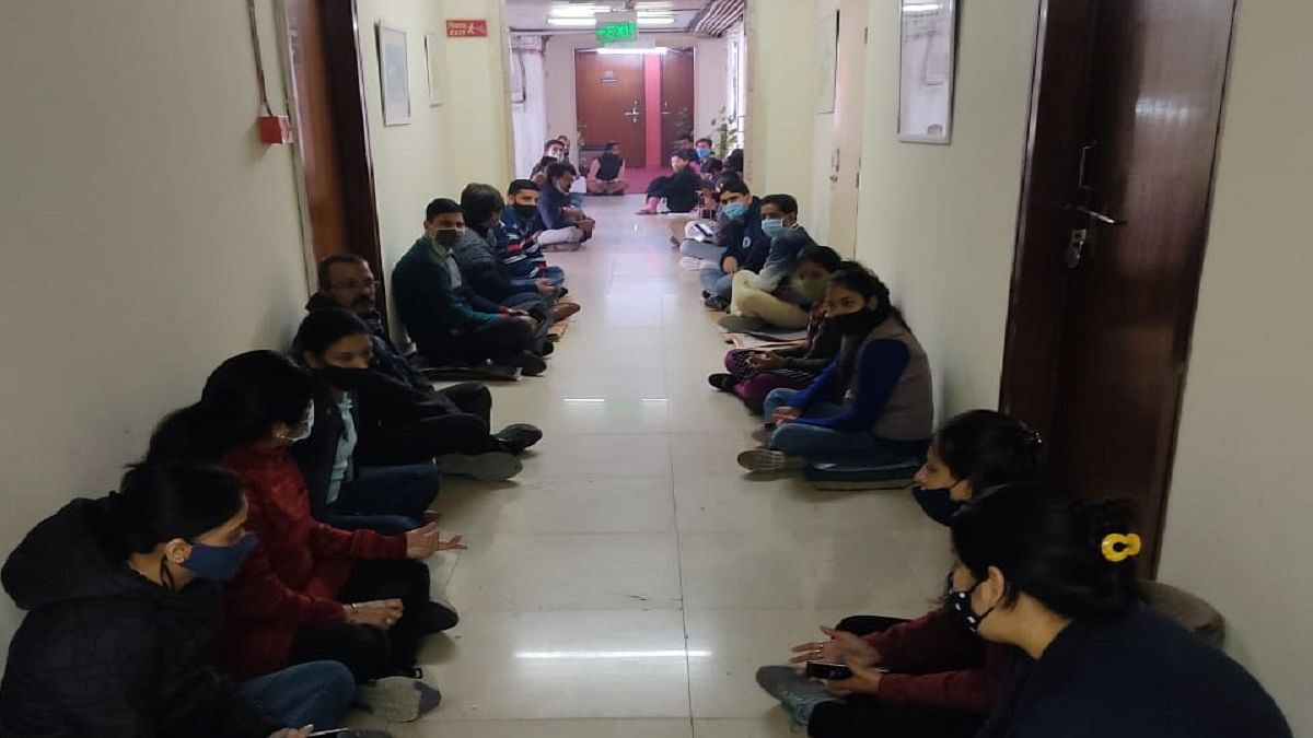 Multi-Skilled Staff (MSS) employees of South Asian University (SAU) demonstrate a sit-in protest in front of the SAU President's office