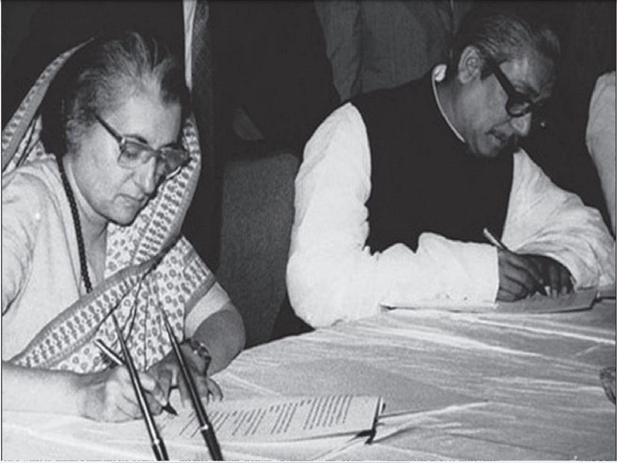 Indian PM Indira Gandhi (left) and Bangladesh PM Sheikh Mujibur Rahman sign treaty of friendship in Dhaka on March 19, 1972