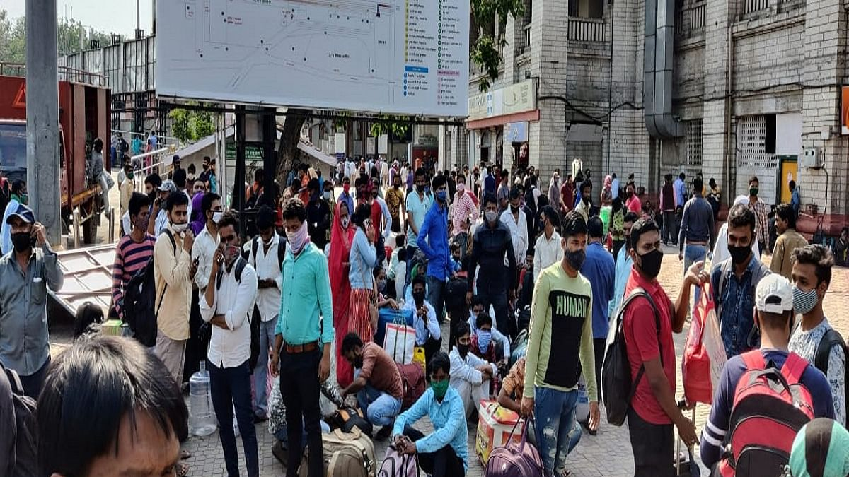 Fearing last year's lockdown experience, migrant workers across India begin to leave for home
