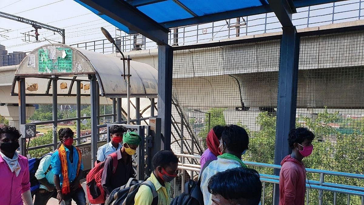 Migrant workers return to Delhi for work as unlock begins