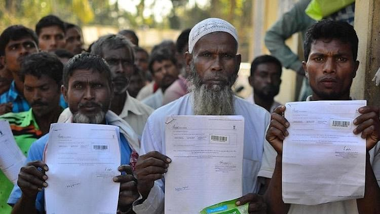 People show their documents during NRC exercise in Assam