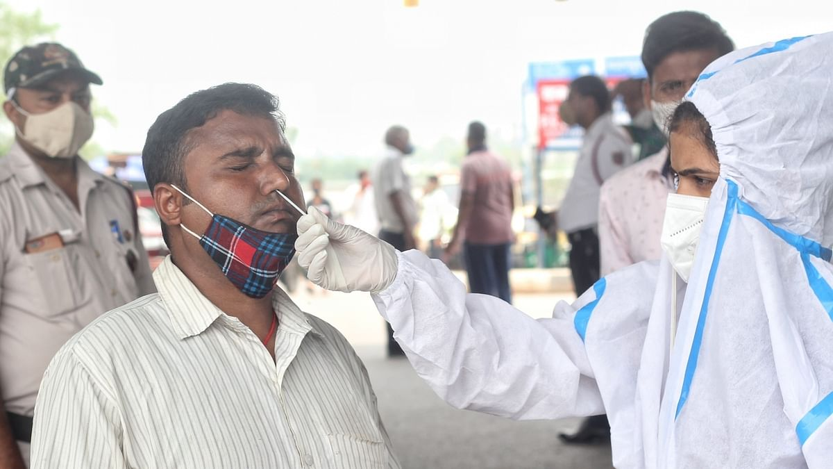 India reports over 43,000 new COVID cases, 911 deaths