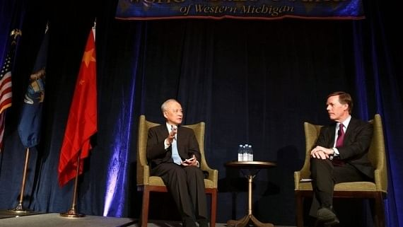 Chinese Ambassador to the United States Cui Tiankai (L) has a conversation with former U.S. Under Secretary of State Nicholas Burns at Grand Rapids, the United States, Feb. 8, 2019
