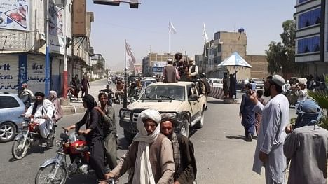 Taliban mark Afghan independence amid chaos, protests and reports of several dead during rally