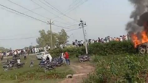 A vehicle torched by angry farmers
