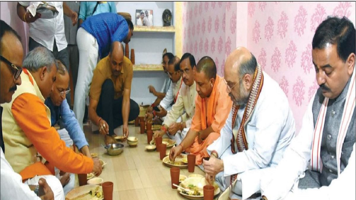 Amit Shah, Yogi Adityanath, Keshav Maurya and Dinesh Sharma having lunch at a BJP worker's house in Lucknow