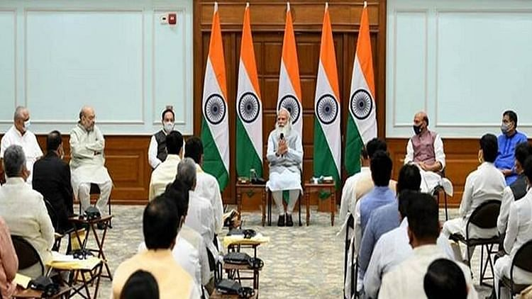 Modi with would-be ministers ahead of cabinet reshuffle in July