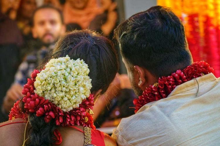 Kerala: Bride, groom reach flooded hall in cooking vessel, get married