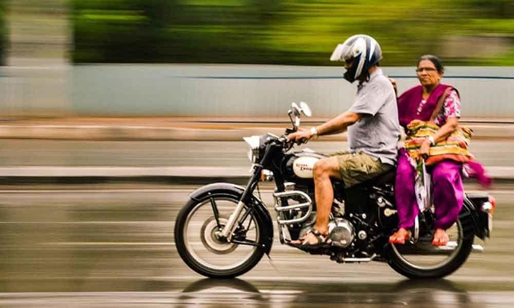 Goodbye to license if pillion rider not wearing helmet in Kerala