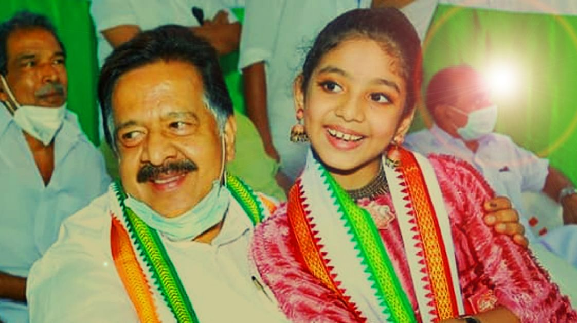 Ramesh Chennithala pampering a child singer at an event in Malappuram
