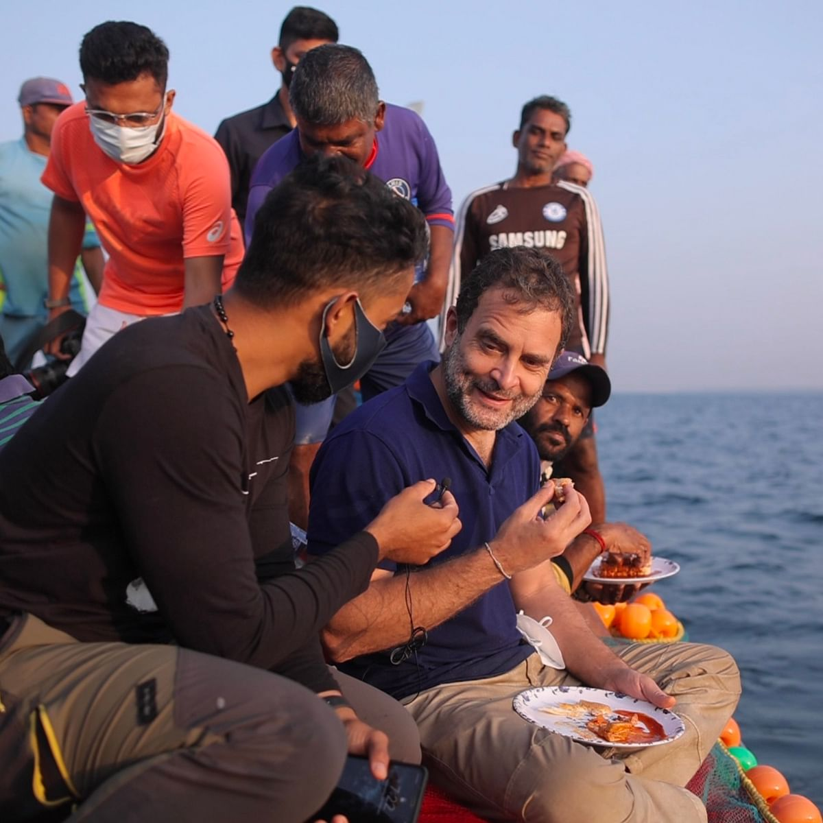 Rahul gandhi having food with the boat's crew