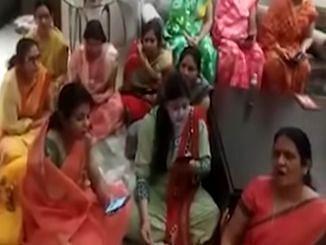 Screen grab of the group of women singing Corona bhaag ja