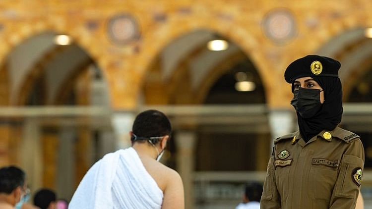 Pictures of the first ever women security guards on duty at Saudi Arabia's Grand Mosque go viral