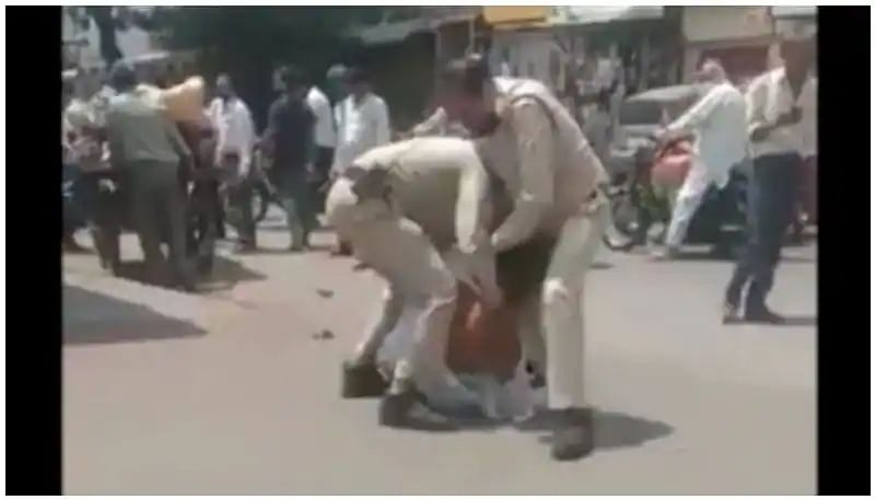 Madhya Pradesh police assault a man in front of his son for not wearing a mask; officers suspended