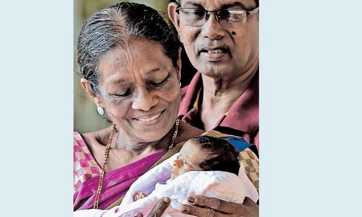 Sudharma and Surendran along with their baby