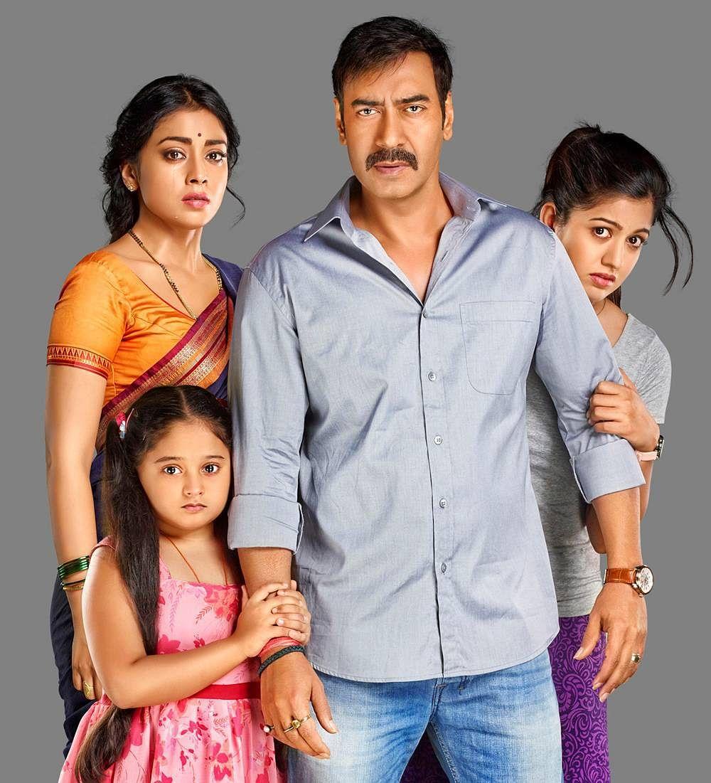 A poster of the Hindi remake of Drishyam