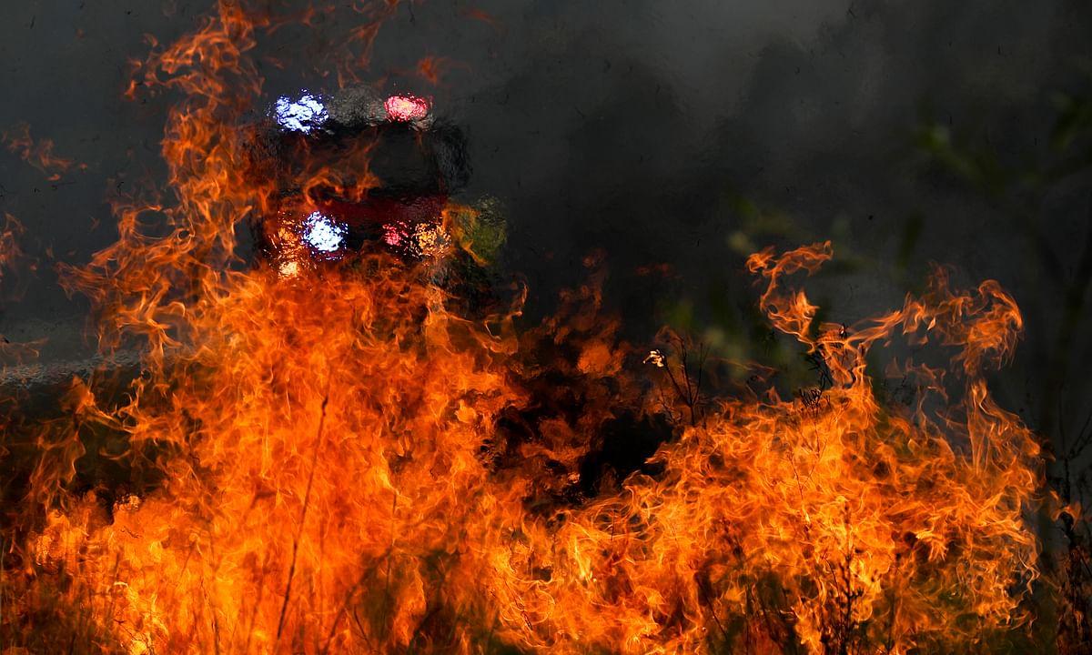 File photo of firefighters battling bushfires near Taree, New South Wales, Australia, on November 11, 2019.