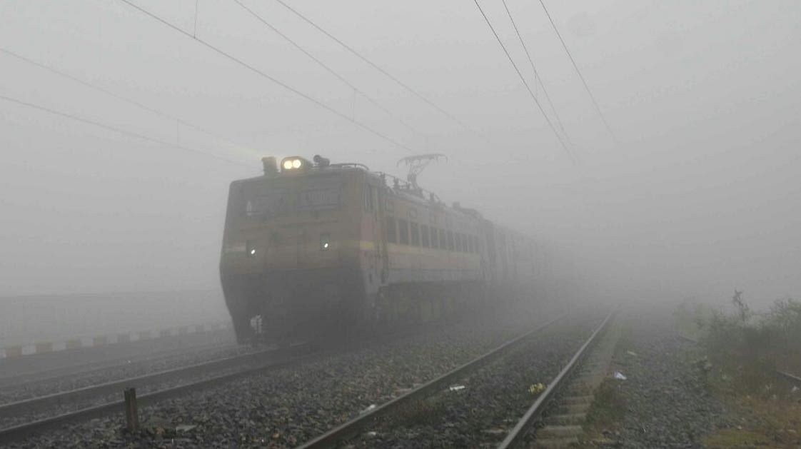 Train running through thick fog