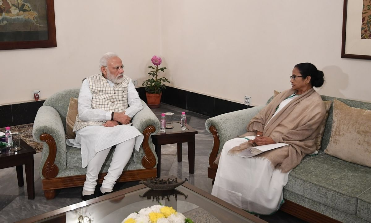 West Bengal Chief Minister Mamata Banerjee meeting Prime Minister Narendra Modi, in Kolkata on Januay 11, 2020.
