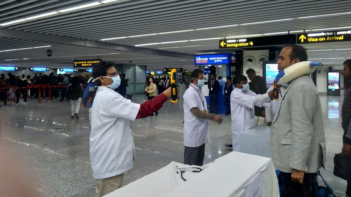 Passengers from China being screened by hand-held thermal devices for symptoms of novel coronavirus at Kolkata airport.