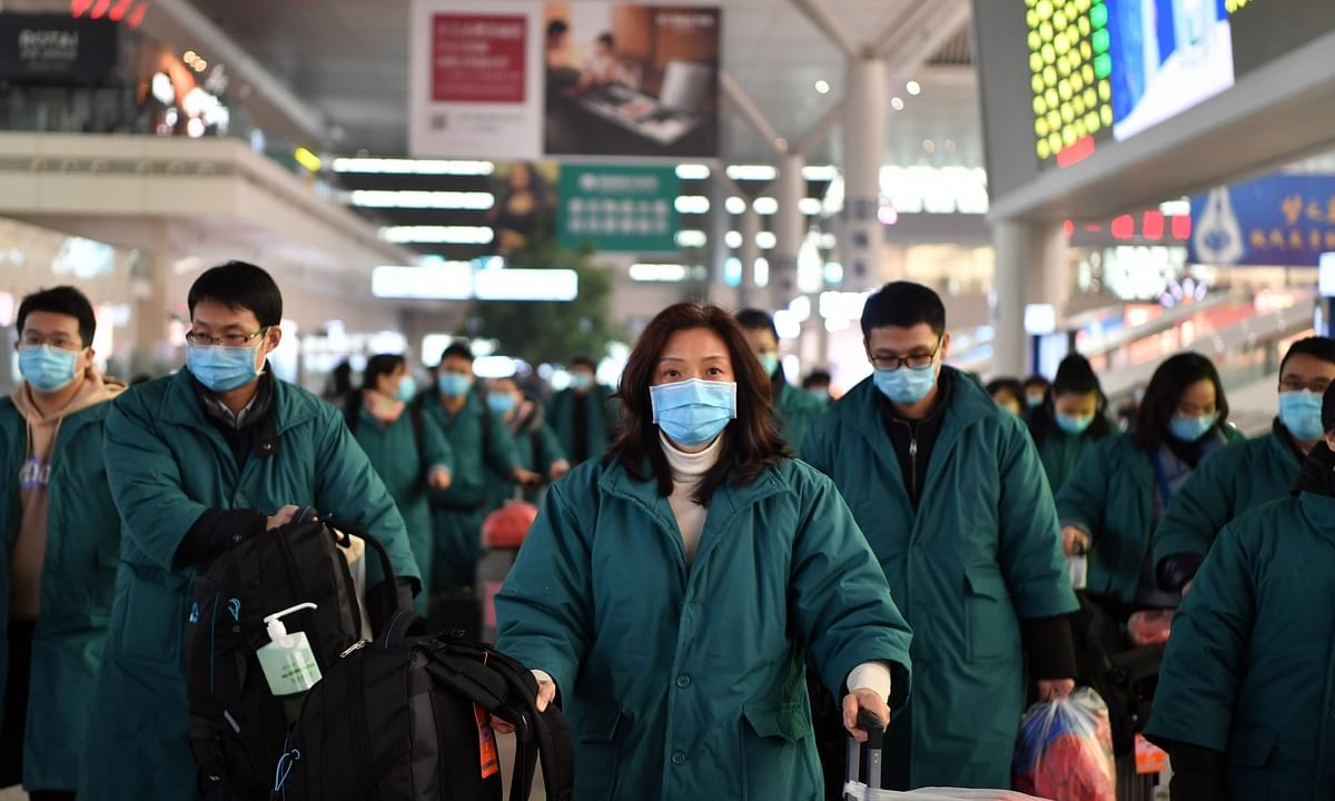 Members of a medical team preparing to board a train at Zhengzhou East railway station in Zhengzhou, central China's Henan Province, for Wuhan to assist in the coronavirus control efforts there, on January 26, 2020.
