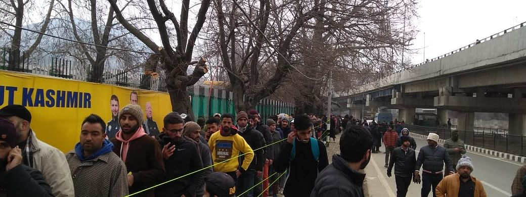 People queuing up outside a stadium to watch the I-League football match  between Real Kashmir Football Club and Mohun Bagan, in Srinagar on January 5, 2020.