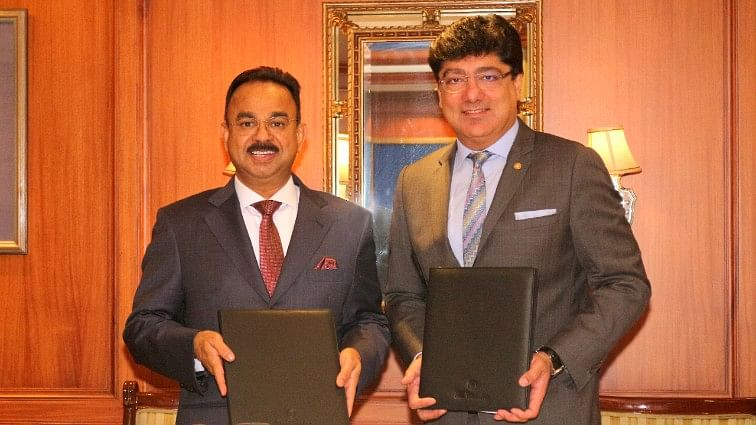 K. Muraleedharan, Chairman and MD, Muralya Hotels & Resorts Pvt with Puneet Chhatwal, Managing Director and Chief Executive Officer, The Indian Hotels Company Limited after the signing of a Vivanta hotel in Thiruvananthapuram.