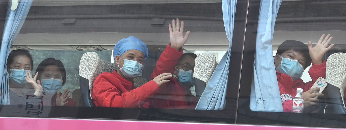 Members of a medical team leaving for Wuhan -- the city worst-hit by the novel coronavirus outbreak in China -- from Nanning in south China's Guangxi Zhuang Autonomous Region, on February 21, 2020.