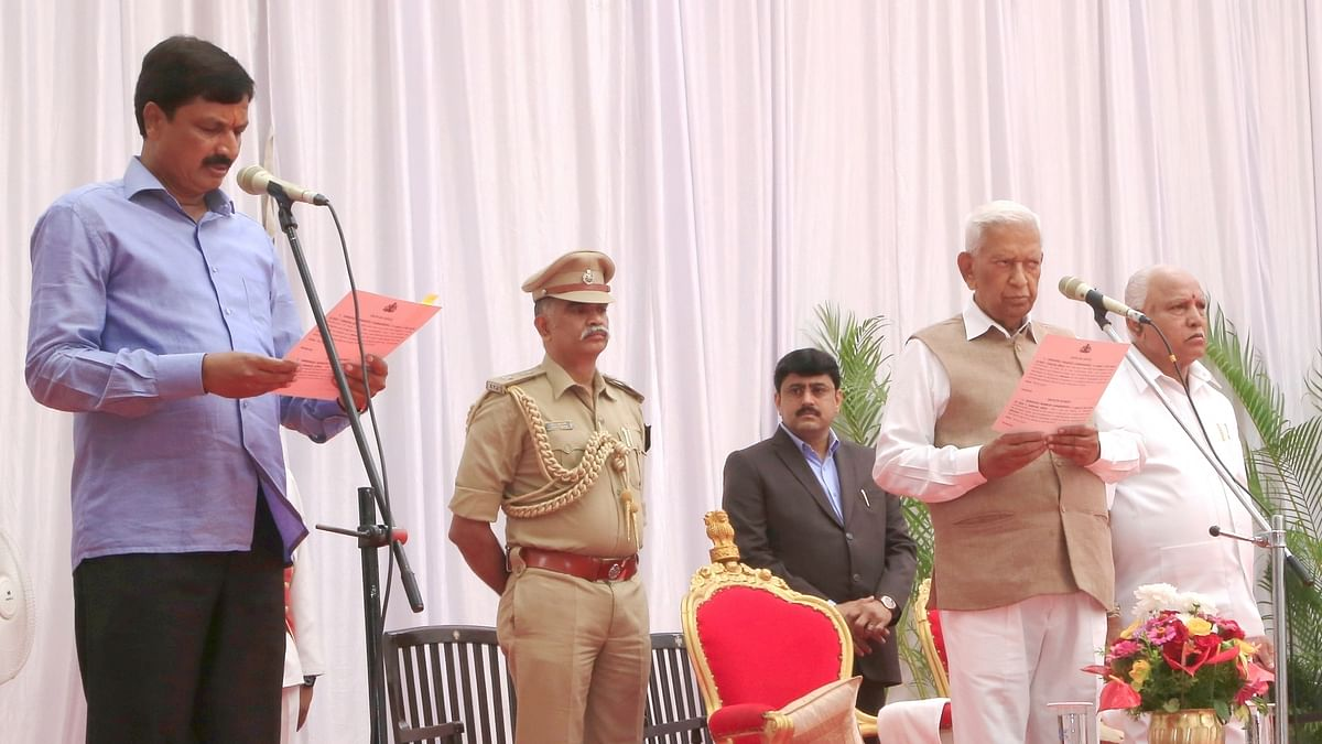 Karnataka Governor Vajubhai Vala administering the oath of office to Ramesh Jarakiholi as a new Cabinet Minister at a swearing-in ceremony held at Raj Bhavan, in Bengaluru on February 6, 2020.