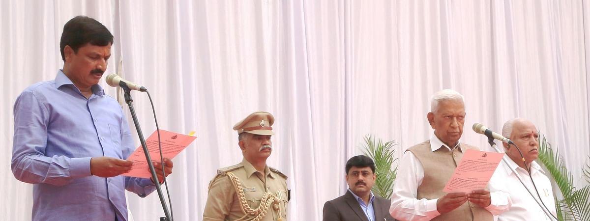 Karnataka Governor Vajubhai Vala administering the oath of office to Ramesh Jarakiholi as a new Cabinet Minister at a swearing-in ceremony held at Raj Bhavan, in Bengaluru on February 6, 2020.