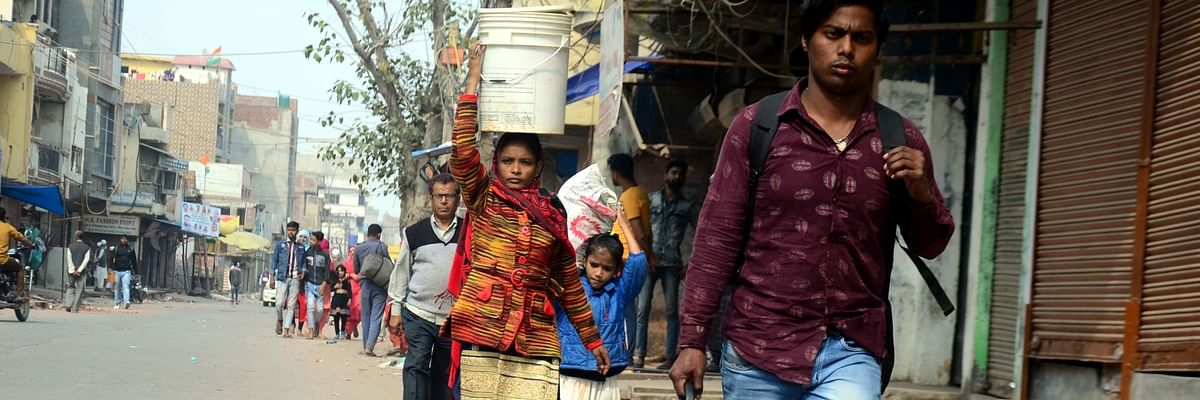 A family in Northeast Delhi leaving for safer places after three days of violence in that part of the national capital, on February 28, 2020.