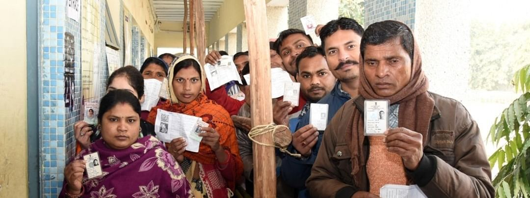 Voters outside a polling booth  in Delhi during the Delhi Assembly elections on February 8, 2020