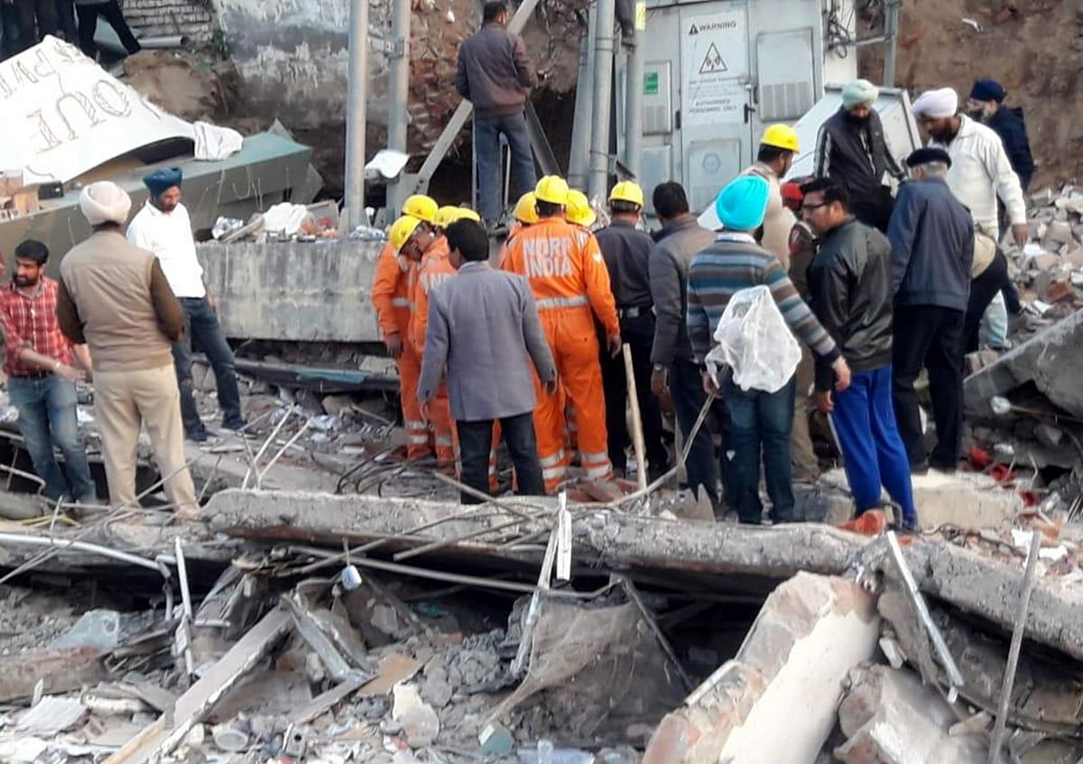 A team of National Disaster Response Force (NDRF) carrying out rescue and search operations after a three-storeyed building collapsed in Punjab's Mohali on February 8, 2020.