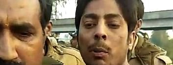 A man who allegedly fired three bullets in the air in Delhi's Shaheen Bagh area, where an anti-Citizenship (Amendment) Act (CAA) protest has been underway for over a month, being whisked away by the police on February 1, 2020.