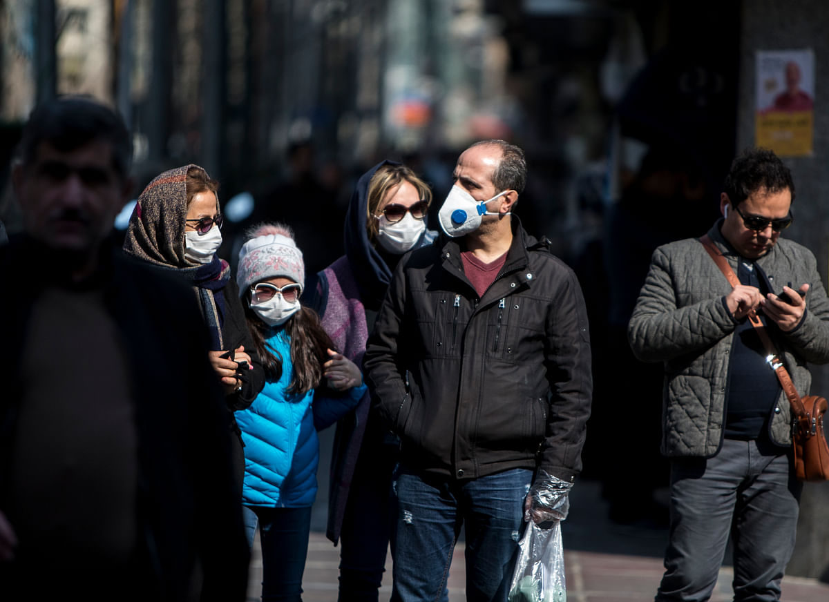 People wearing masks in downtown Tehran on February 23, 2020 as part of the efforts to prevent the spread of coronavirus in Iran.