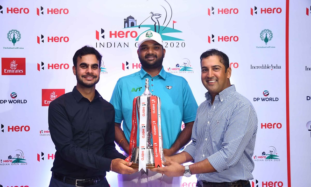 Golfers Shubhankar Sharma, Udayan Mane and Shiv Kapur with the Hero Indian Open trophy.