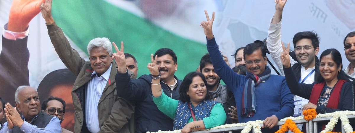 Delhi Chief Minister Arvind Kejriwal celebrates his Aam Aadmi Party's landslide victory in the Delhi Assembly elections 2020, along with other party leaders, at its office in New Delhi on February 11, 2020.