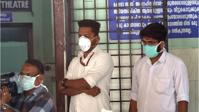 People wearing masks as a precaution against the coronavirus (2019-nCoV) outside a hospital in Thrissur, Kerala on January 31, 2020.