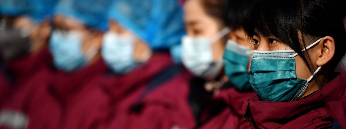 Members of a medical team at a ceremony before leaving for Hubei Province in Xi'an, northwest China's Shaanxi Province, on February 21, 2020.