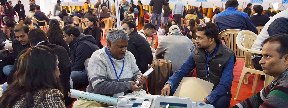 Polling officials checking the Electronic Voting Machine (EVMs) and other necessary inputs required for the Delhi Assembly Election, at a distribution centre, at Kamla Nehru College, in New Delhi on February 07, 2020.
