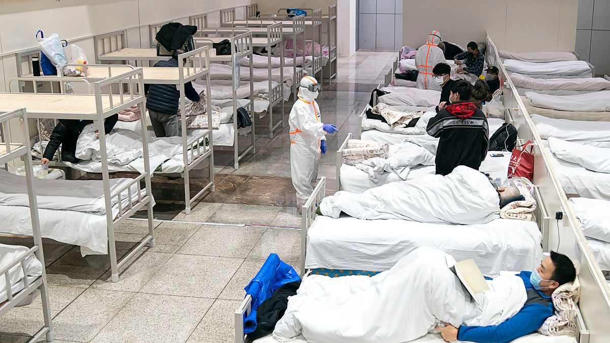 Patients infected with the novel coronavirus are seen at a makeshift hospital converted from an exhibition centre in Wuhan, central China's Hubei Province, on February 5, 2020.