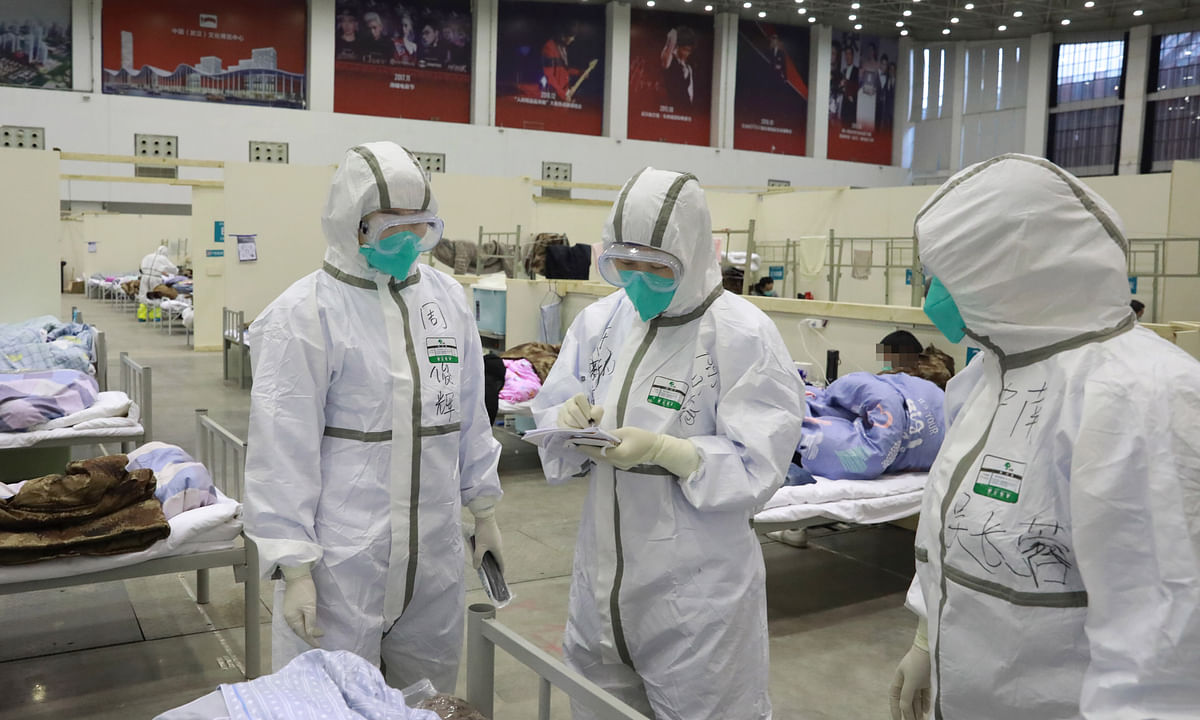 """Medical workers work at """"Wuhan Livingroom"""" in Wuhan, central China's Hubei Province, on February. 8, 2020. The cultural building complex is a converted hospital to receive patients infected with the novel coronavirus."""