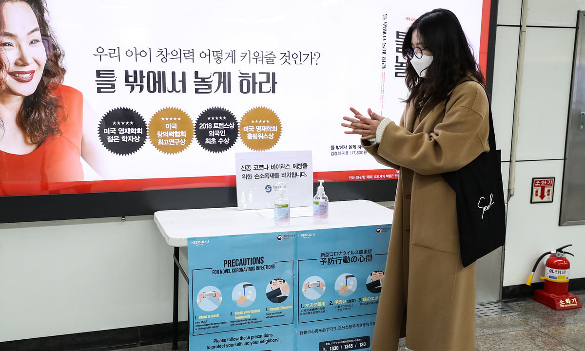 A woman disinfects herself at Gwanghwamun Station in Seoul, South Korea, on February 18, 2020.